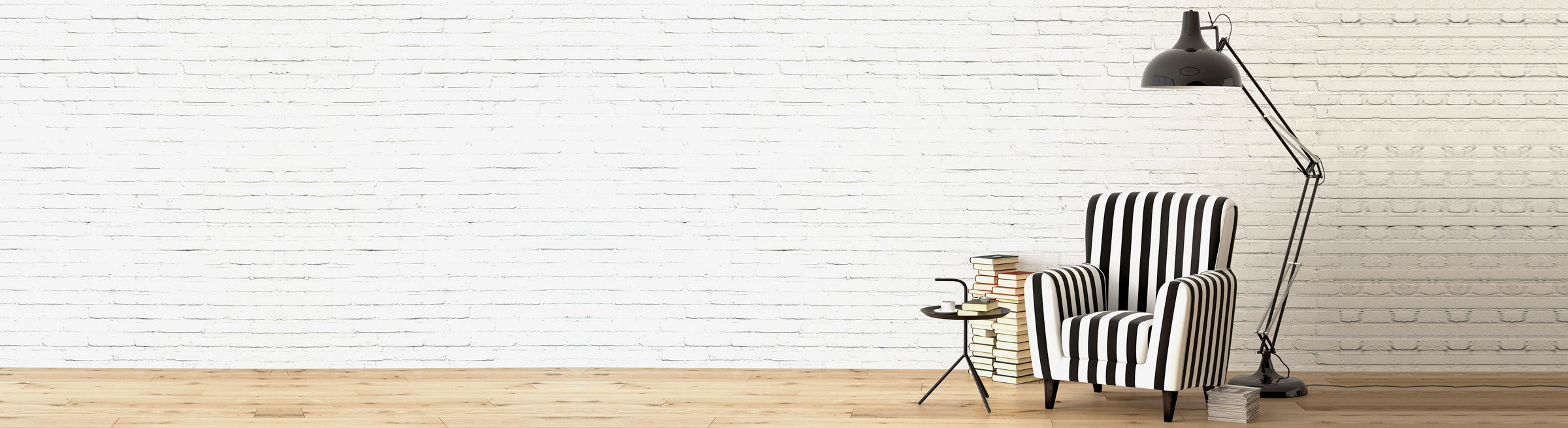 Slider image of chair in front of white brick wall