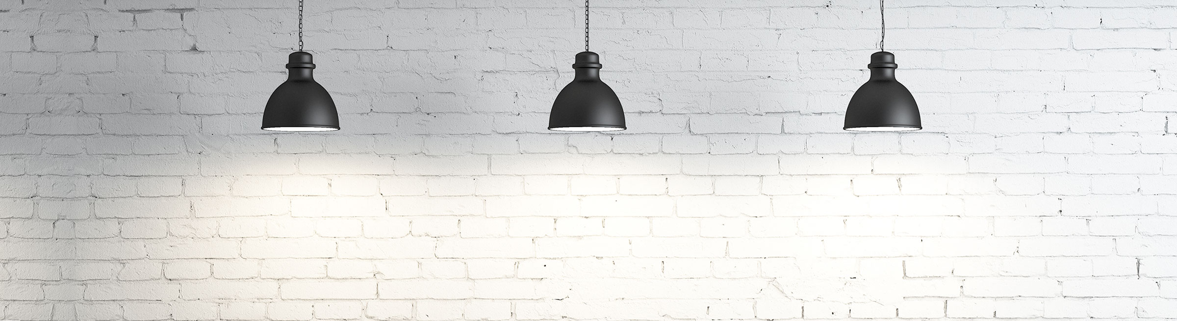 Slider image with lights and white brick background